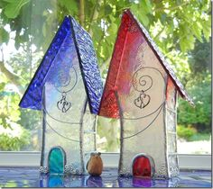 glass houses red and blue together window