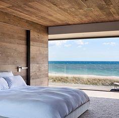 Wooden bedroom with big window
