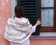 A short, fat shawl with a large center lace panel. A thickish yarn and garter stitch make it quite warm.