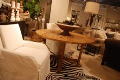 Great mixture of elements!  Raw wood and faux animal print with a neutral accent chair.  Good look!  #HPMKT #FauxAnimalPrintRug