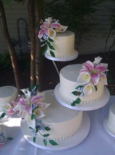 Butter Cream Cake With Sugar Stargazer Lilies, Calla Lilies And Stephanotis With Ladybugs This was for a very casual lakeside wedding and...