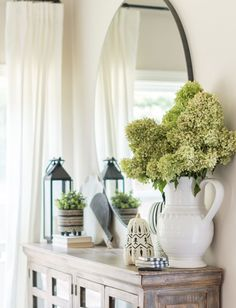 Kelley Nan dressed up her tabletop with decorative plants for a look that's naturally chic. How will you add a little green to your space? Available at At Home. Dining Room Decor, Home Decor Inspiration, Decor, Decor Inspiration, Lantern Decor Living, Buffet Table Decor, Dining Room Console Table, Sideboard Decor Dining Room, Sideboard Decor