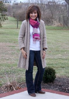 Almost had this exact outfit on today!  Darker brown sweater, coral and pink scarf, coral blouse, jeans and brown boots.  Great minds think alike!  @Metra Roberts Fashion Over 40-What I Wore