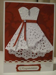 Interesting how the dress is made out of a paper doily.