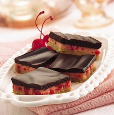 DESCRIPTION  Simple chocolate-topped bars have a creamy filling and tender cookie crust.  INGREDIENTS  1 roll (16.5 oz) Pillsbury® refrigerated sugar cookies 1 egg, separated 1 package (8 oz) cream cheese, softened 2 eggs 1 can (14 oz) sweetened cond -After a great meal, enjoy an e-cigarette with your prefered e-liquid flavor at www.e-cigarilicious.com #ecigarette #eliquid #ecig #vaporizer
