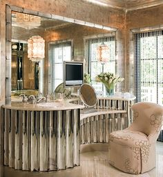 In Los Angeles, designer Craig Wright and architect Richard Manion restored a 1930s Paul R. Williams house to its original Hollywood glamour. Inspired by Dorothy Draper, Wright commissioned a period-style fluted, mirrored base for the vanity in the bathroom. (February 2010)
