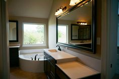 Master bathroom, large soaking tub, his and her's vanities #mcbeehomes