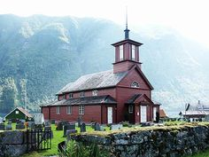 The Fjærland church was built in 1863. It stands in   Mundal    Mundal    Mundal   near the inner end of Fjærlandsfjorden.