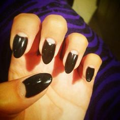 Stiletto nails with accent moons in Black Shadow Gelish by Nita