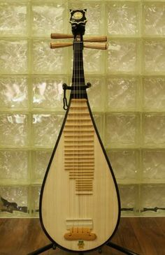 Dunhuang Pipa - Chinese Guitar / Lute by Dunhuang. $229.00. The pipa (Chinese: ??; pinyin: pípá) is a four-stringed Chinese musical instrument, belonging to the plucked category of instruments (????/????). Sometimes called the Chinese lute, the instrument has a pear-shaped wooden body with a varying number of frets ranging from 12-26. Another Chinese 4 string plucked lute is the liuqin, which looks like a smaller version of the pipa.. Save 54%!
