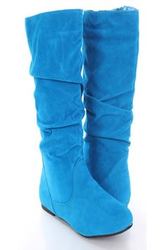 Make a fashion statement with these sexy mid calf boots! They will look super hot paired with your favorite skinnies or dress. Make sure you add these to your closet, it definitely is a must have! It features faux suede, side zipper, closed toe, slouchy shaft, stitched lining, and cushioned footbed. Approximately 13 inch shaft and 15 inch circumference.