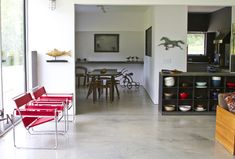 Bright red Wassily Chairs add a splash of color to this Massachusetts folk art gallery and home | Knoll Inspiration