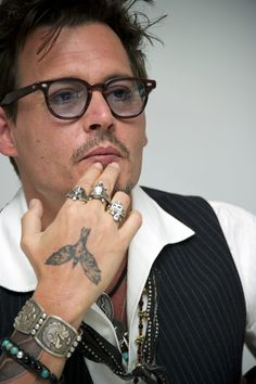 Johnny Depp http://www.bubblews.com/news/771544-johnny-depp-on-justin-bieber-his-12-year-old-daughter-isn039t-a-belieber-anymore