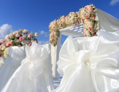 Ribbons and the blue sky, with a floral arch topping!
