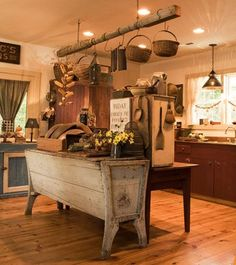 Very cozy, rustic way of decorating and adding display/storage space in a big kitchen.