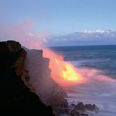 Molten lava pours into the Pacific near Kalapana, just east of Hawai'i Volcanoes N.P.  Near constant eruptions—its eastern flanks have been erupting since 1983, Kilauea Caldera since 2003—make the park's Kilauea Volcano one of the most active in the world.