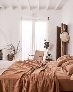 rust colored washed linen bedding. / sfgirlbybay