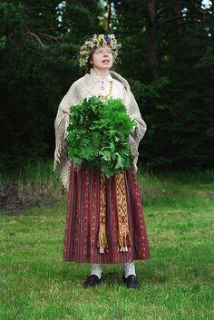 Ligo night festival. Latvian national costume (Augšzeme). Latvia