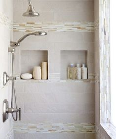 LOVE the different sized tiles here...and the colors are VERY nice for a shower.