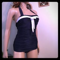 Hot NAVY BLUE SAILOR LIKE INSPIRED 1pc swim suit M VINTAGE INSPIRED SAILOR , features white area across breast & ties in a bow. This is a 1-piece fullback runched sides, covering the hips as well as flattering the tummy! Yippee!  Its Super cute! Halter top w/ LIGHTLY padded bust! NO UNDERWIRE! Says extra-large but it WILL NOT FIT an extra large SO I have listed it as a medium! It will fit a sz 5-8 medium sized lady very nice! My mannequin is a true size 10 and it's snug on her. This Is…
