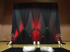 Love the black fabric and red lighting for this backdrop!