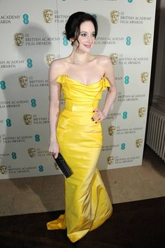 A pop of colour on the red carpet, Andrea Riseborough dressed in Vivienne Westwood and De Beers diamonds at the BAFTAs.