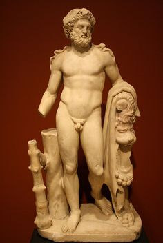 A Roman Marble Statue of Hercules, Recalling the Demi-god's Role as Founder of the Olympic games.Hercules wears a wreath of white poplar leaves and a fillet with its ends trailing over his shoulders.The fillet marks him as an athletic victor, and white poplar was associated with the Olympic Games, which the hero was credited with founding in honor of his father, Zeus.