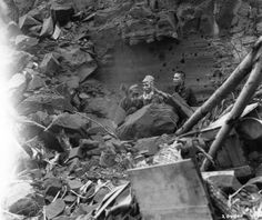 Japanese soldiers emerge from hiding to surrender to American troops. Iwo Jima, Japanese Volcano Islands. 5th of April 1945
