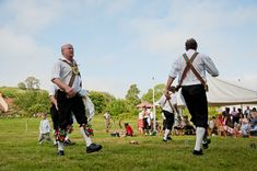 Holly and Dean's village fete wedding with a coconut shy and Morris Men