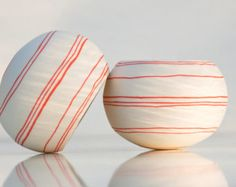 Porcelain candle holder with colorful orange stripes- Tea Light Delight design N.9 (orange). Crafted by Wapa Studio.