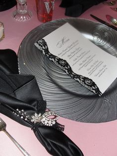 More final results bridal show table.  Loved these charger plates, and hope we get to use them in a real wedding someday.  We added black lace to the menu cards and to tie the napkins and topped them each off with a vintage brooch.  www.makeitdistinctive.com