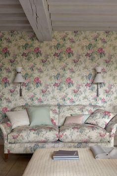 Lush rhododendron flowers and foliage featute in this beautiful floral wallpaper design. Shown here in the pink and forest green colourway.