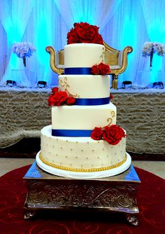 Royal blue, red, and gold cake. Fondant and buttercream wedding cake designed by Cake Couture. relationship wants / royal blue dress for wedding / royal blue wedding dress / blue wedding dress royal / royal blue wedding Royal Blue Cake, Royal Blue Wedding Cakes, Blue Red Wedding, Wedding Cake Red, Bleu Royal, Royal Blue And Gold, Cool Wedding Cakes, Wedding Cake Designs, Blue Gold