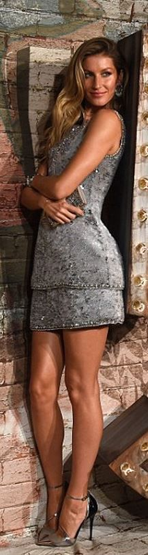 Who made  Gisele Bundchen's silver dress and black pumps