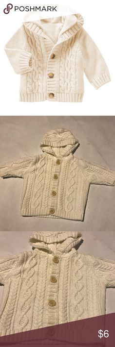 Gymboree Cable Knit Button Up Sweater Unisex sweater! Adorable for boy or girl! Cream in color. Size 0-3 months. Good, long sleeves, buttons up. No flaws that I can find. In EUC! Name brand Gymboree. Please note ** first pic IS NOT same product just a similar one! Gymboree Shirts & Tops Sweaters