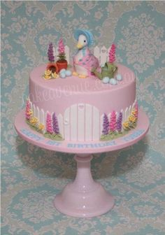 Inspired by my original Peter Rabbit Cake, this cake has been redesigned for a little girl's first birthday. Features Jemima Puddle-Duck with her eggs hidden amongst the garden. All decorations are hand crafted from fondant. I am a huge fan of. Candy Bar Comunion, Beatrix Potter Cake, Peter Rabbit Cake, Duck Cake, 1st Birthday Cakes, Pink Birthday, Fantasy Cake, Garden Cakes, Gateaux Cake