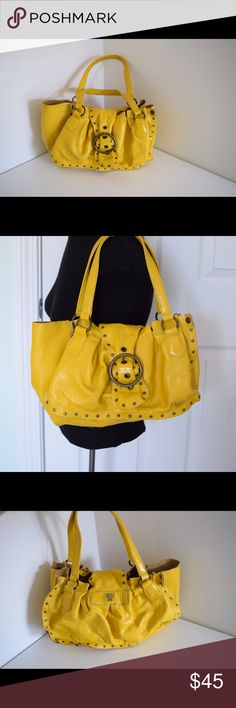 """Ann Sui leather shoulder bag studded Anna Sui studded leather tote bag Measures 14"""" x 9"""" shoulder drop 9"""". Snap closure. Leather in yellow (almost mustard color). Brass tone studs. Anna Sui logo Inside has ink marks (pic). Outside has one ink mark on back & one on front (pics). Beautiful bag. $200 new Anna Sui Bags Shoulder Bags"""