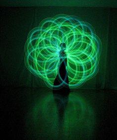 Poi Dancing  -Green Flower  - I love dancing Poi.  So much fun.