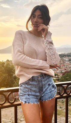 cool outfit   nude sweater and printed denim shorts