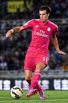 Gareth Bale of Real Madrid CF runs with the ball during the La Liga match between Real Sociedad de Futbol and Real Madrid CF at Estadio Anoeta on August 31, 2014 in San Sebastian, Spain.