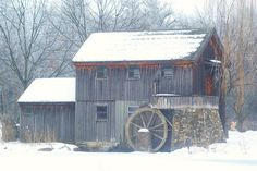 Mill at Midway Village Museum, Rockford Illinois - this is a working water wheel in the summer.