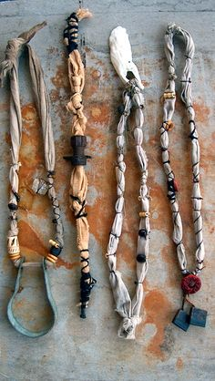 recycled materials (linen from tablecloth, bolts, pipes, shell, yarn from unraveled sweater) with bamboo and clay beads