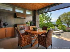 You'll never want to come inside when you have and outdoor kitchen/entertainment area like this one.