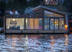 A small floating home on Portage Bay in Seattle, Washington. Designed by Ninebark Design Build.