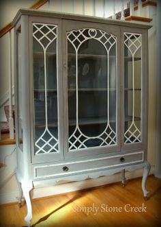 China Cabinet painted with Amy Howard At Home One-Step Paint in Atelier with white trim