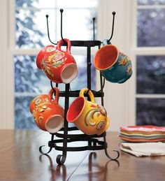 I need two or three of these!  Coffee Mug Tree!  I LOVE coffee cups and I have a TON!  This would be perfect to display some of my favorites!