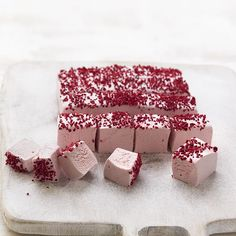 Fluffy raspberry and rose marshmallow sprinkled with chopped freeze dried strawberries. Pop these cute marshmallows in a pretty box and give them to Mum this Mother's Day!