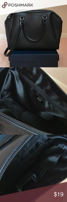"""H&M Black Bag With Shoulder Strap H&M Black Bag With Shoulder Strap. Gently used a couple of times. Detachable strap. Strap is approximately 12"""" from the top of the strap to the top of the bag. For reference, I'm about 5'0"""" tall and this bag looks great when worn just over the shoulder, but appears a little short when worn as a crossbody. The bag is approximately 13"""" in length (measured from bottom of the bag) and 10.5"""" in height. This bag did not include a dust bag, but I will provide one…"""