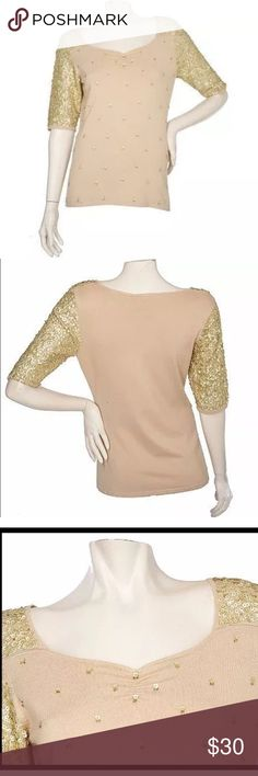 M By Marc Bouwer Richard Sequin Gold Sweater Large This shimmery sweater--with fitted elbow sleeves and a ruched sweetheart neckline--will make you the bell of the ball. From M by Marc Bouwer. Straight bottom hem, allover sequins on sleeves; scattered across bodice front Size Large 75% rayon/25% nylon, exclusive of decoration Hand wash, dry flat Retail Value: $79.00 Marc Bouwer Sweaters