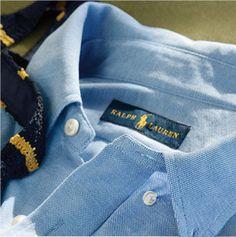 Close-up of button-down collar of blue sport shirt